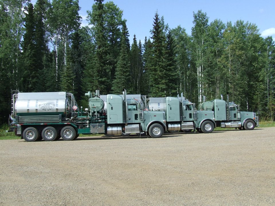 side view of multiple trucks